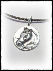 Ezüst domború antikolt ló medál